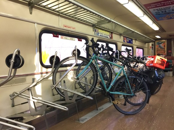 Seats are removed to accommodate bike racks to hold bikes during the trip.