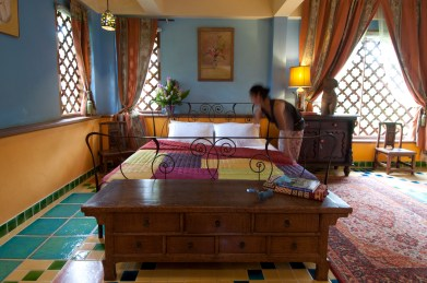 Turning down the bed in the Moroccan suite