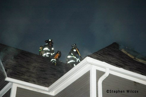 Wheaton house fire on Ellis 6/17/11 firefighters ventilate the roof