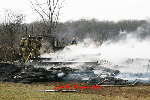 smoldering remains of a barn fire