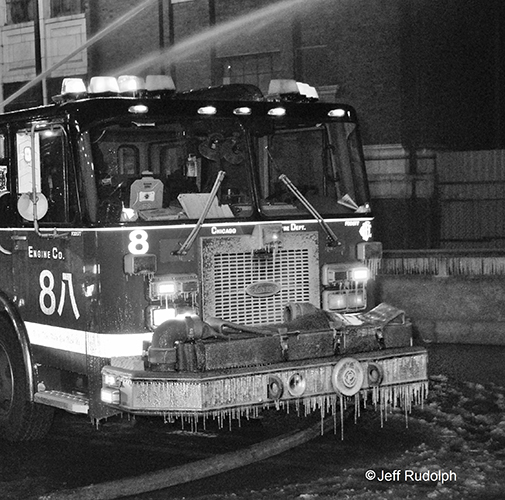 black and white photo of fire engine covered with ice