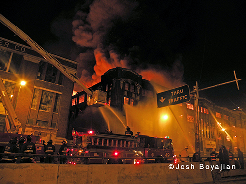 firefighters work at nighttime fire