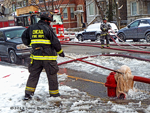 Chicago fireman thaws frozen fire hydrant