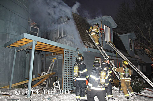 firemen working at night time winter house fire
