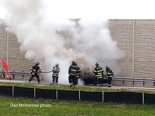 firemen extinguish car fire