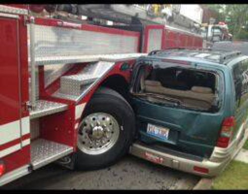 fire truck hits parked car