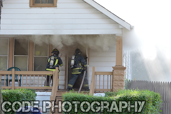 firemen enter house filled with smoke
