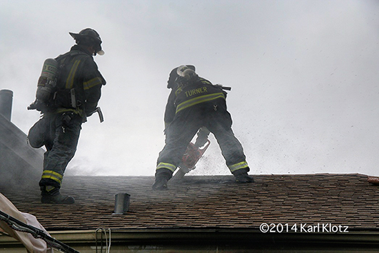 firemen cut roof to ventilate fire