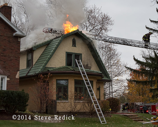 flames through roof of a house