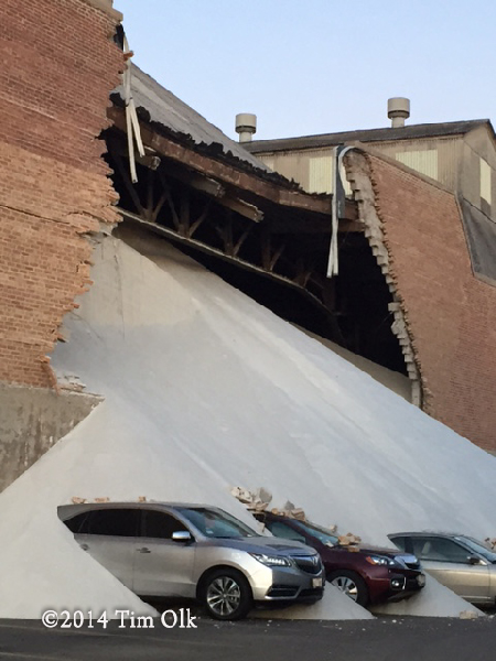 tons of salt crushes cars after wall gives way