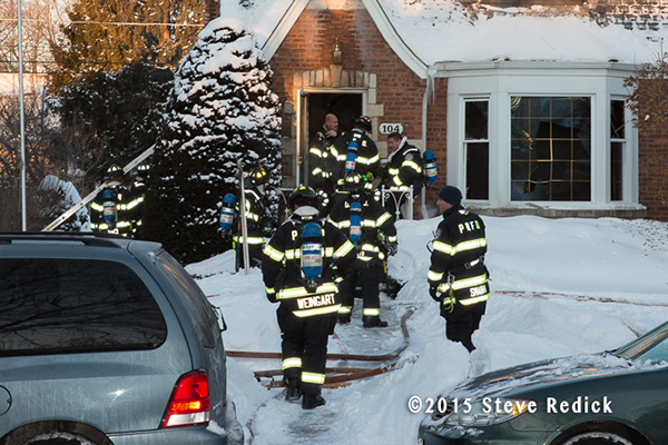 firemen at a winter house fire