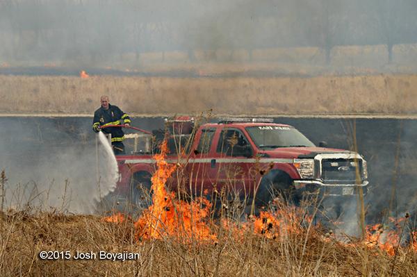 firemen fight a grass fire