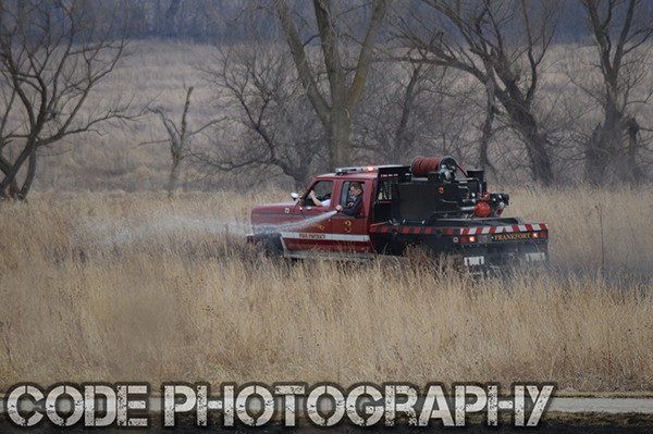 Frankfort FPD firefighters extinguish a grass fire
