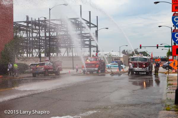old fire engines flowing water at muster