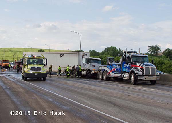 tow truck with semi on highway