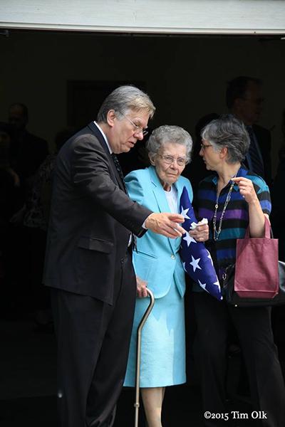 widow of Firefighter receives flag
