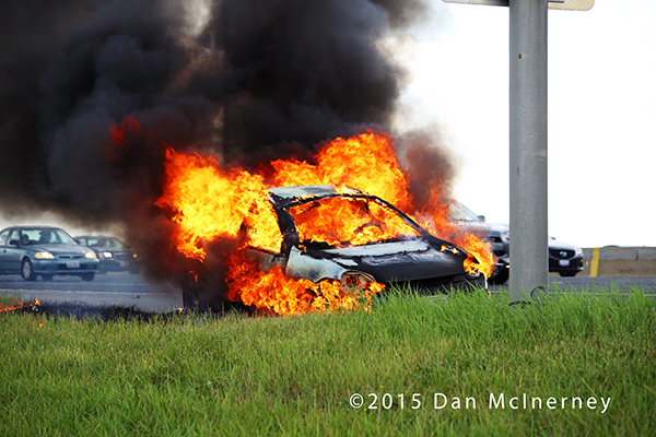 car fully engulfed in flames
