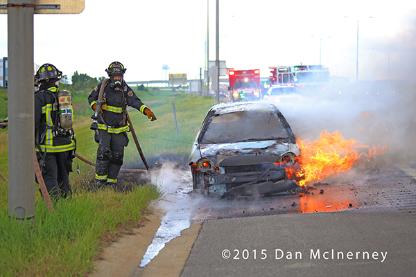 firemen extinguish a car fire