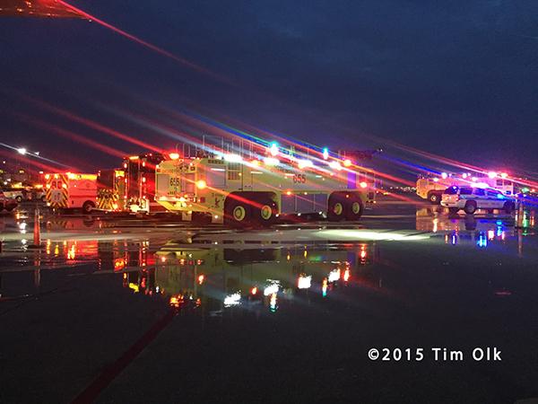 night photo of airport fire trucks