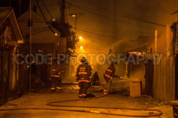 alley garages gutted by fire
