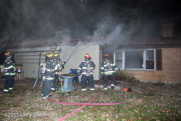 firefighters at night house fire