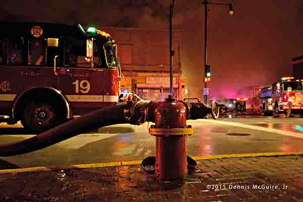 fire engine hooked to hydrant at night