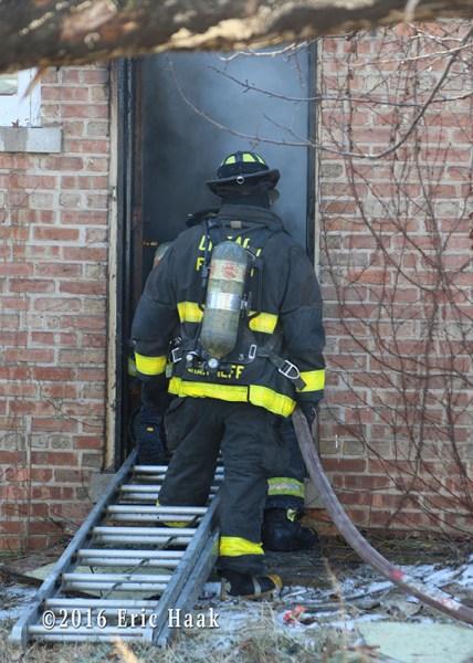 firefighter working a basement fire