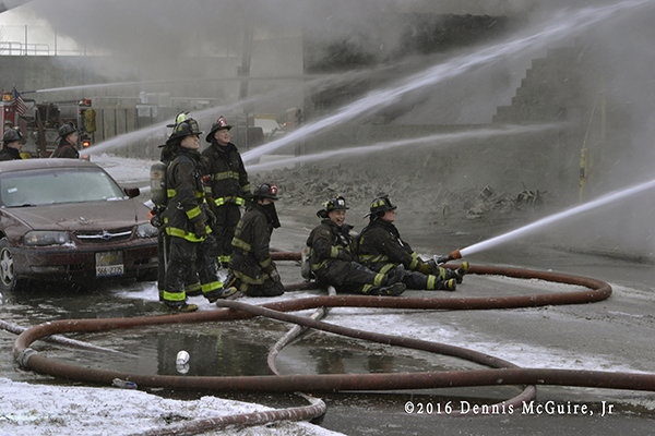 firefighters operate master stream at fire scene