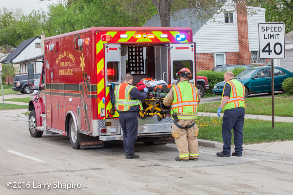 firefighters load patient with Stryker system power load