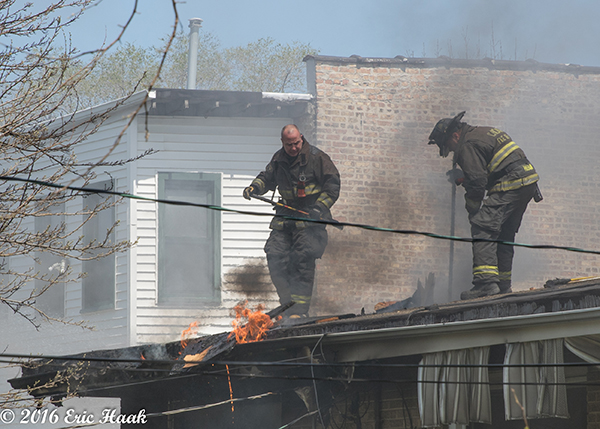Chicago firefighters overhaul after house fire