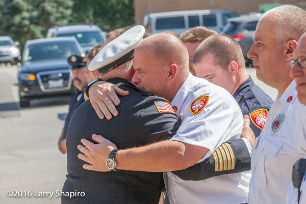 firefighter bids farewell to Prospect Heights Fire District Fire Chief Donald Gould Jr