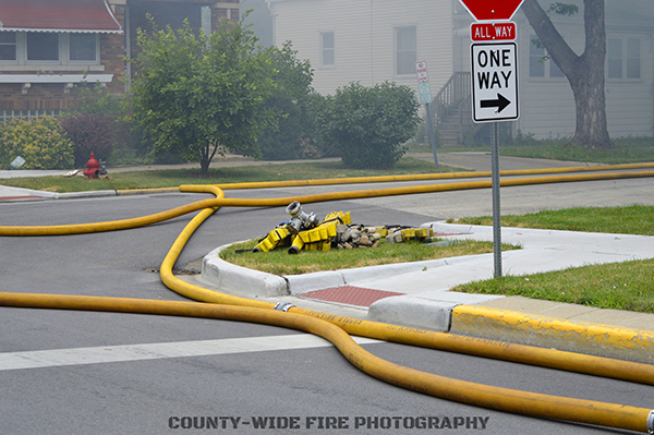 fire scene with hose in the street