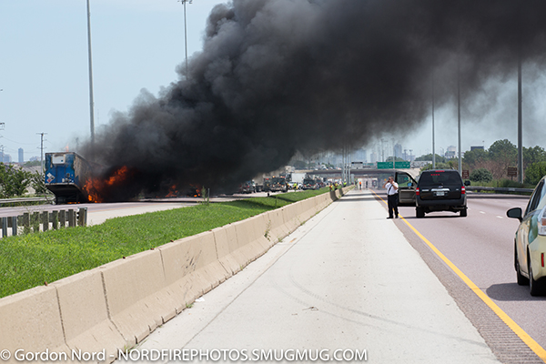 heavy smoke and flames from highway truck crash