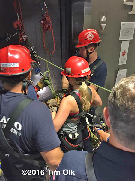 Chicago firefighters rescue woman trapped in elevator