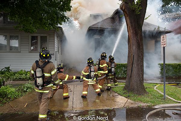 firefighters battle house fire in Berwyn IL