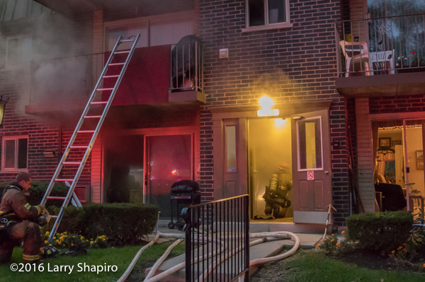 firefighter crouches low for smoke