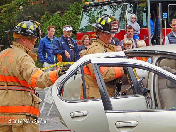 firefighters demonstrate a vehicle extrication