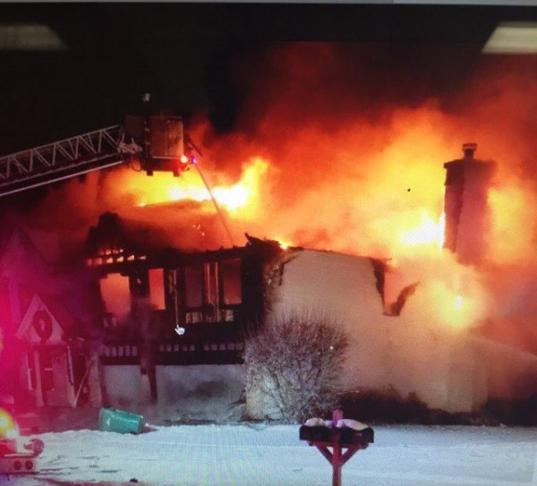 house engulfed in flames