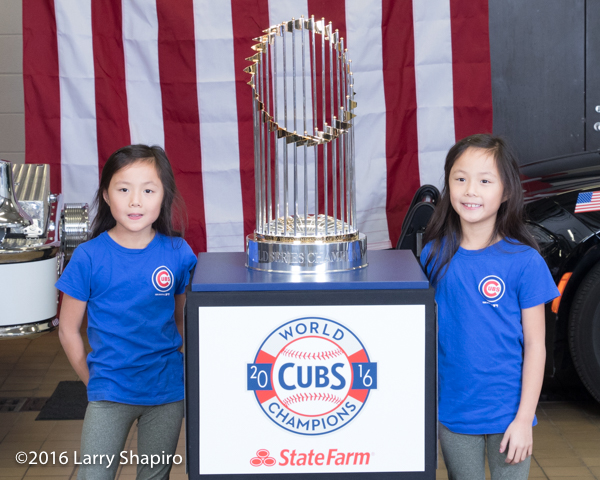 young girls with the World Series championship trophy.
