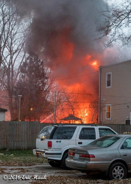house on fire with flames
