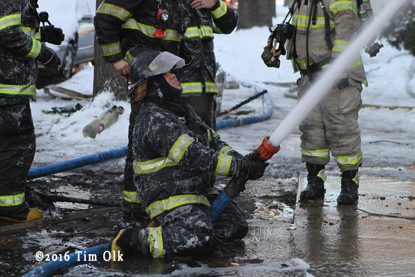 Firefighter encrusted in ice at fire scene