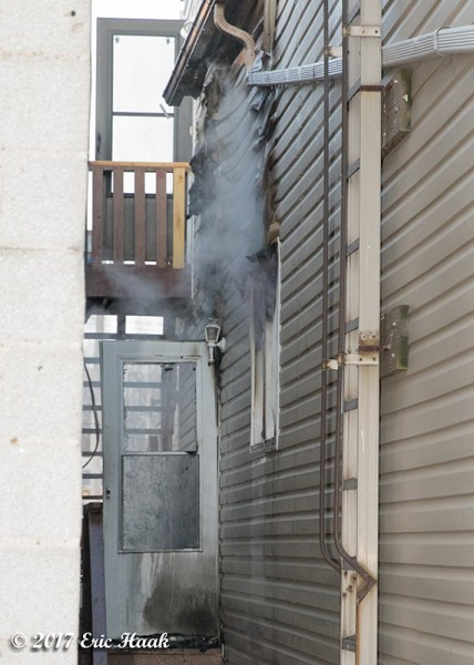 smoke from window during house fire