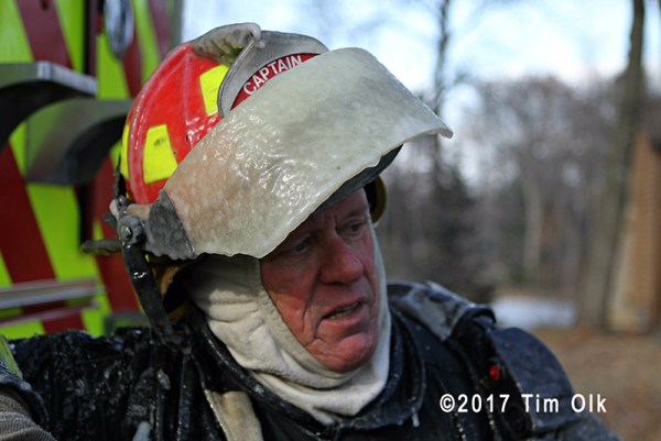 firefighter with ice covered helmet