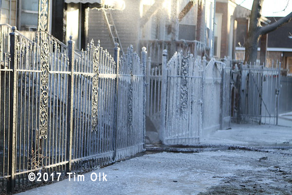 ice covered fence after fire