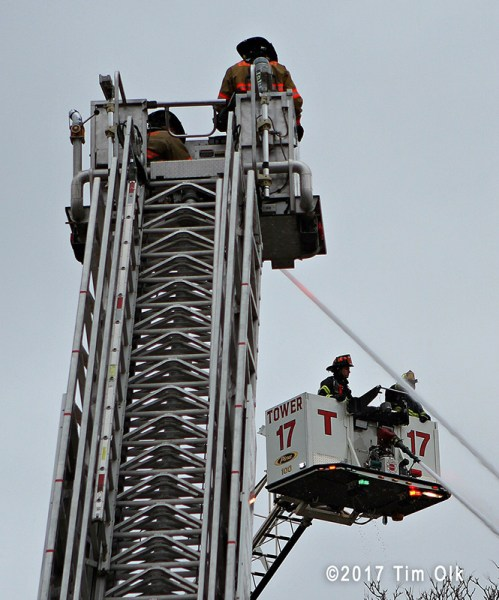 two tower ladders working at fire scene