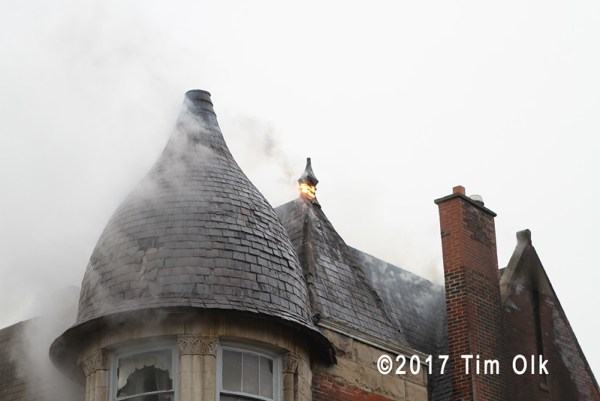 smoke from roof to townhouse on fire