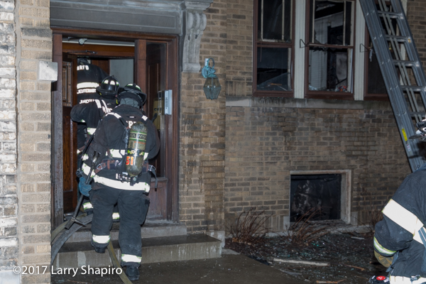 Firefighters enter apartment building after fire