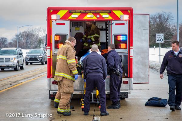 Stryker cot auto load system on ambulance at crash