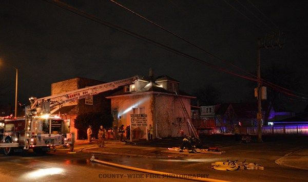 fire scene with ladder truck