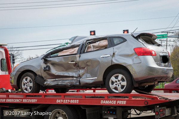 Nissan SUV after t-bone crash and rollover
